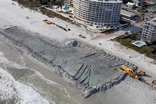 Overhead view of shore restoration project in Duval County, Florida. Image shows an area where new sand is being added to beach.