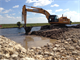 The old Tamiami Trail roadway was broken through May 15 during roadway removal efforts as part of the Tamiami Trail Modifications project in Miami, Fla. The road has served as a longstanding physical barrier, preventing water from flowing into Everglades National Park. While there is still much more work to be done on the project, removal of the one-mile section of roadway will bring the project one step closer to completion. For additional information on the project visit: http://bit.ly/TamiamiTrail