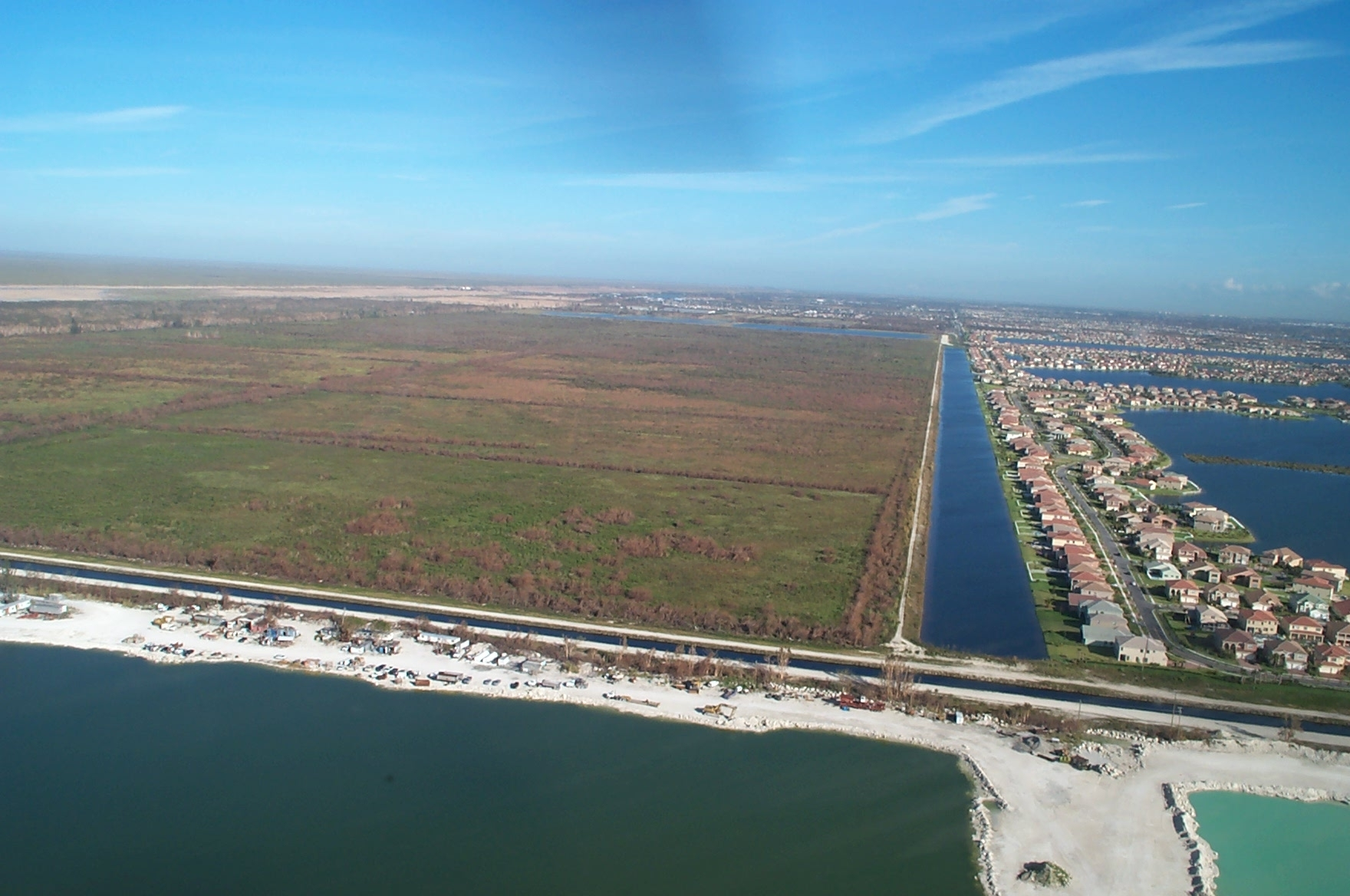 Aerial view of the Broward County Water Preserve Area project area showing one of the water conservation areas and the adjoining canal.